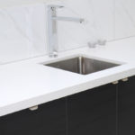 Reconstituted splash back and bench-tops with under slung sink