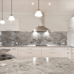Natural Granite bench-tops and splashbacks will give a lift to any kitchen