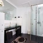 Full framless shower screen & integrated glass vanity top are stunning in this designer bathroom