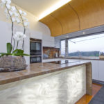 Custom curves with a stunning Corian bench-top and back lit panel